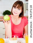 beautiful woman holding a apple - stock photo