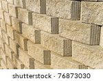 Unique perspective of a curving brick wall for a background. - stock photo