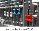 volume sliders on a soundboard - stock photo