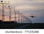 The aircraft is landing at sunset, Prague Ruzyne Airport, Czech Republic. - stock photo