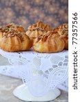 pastry eclairs profiteroles dessert plates - stock photo