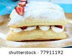 dessert cake of puff pastry, whipped cream and strawberries - stock photo