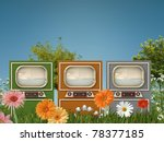 old televisions in a green garden - stock photo