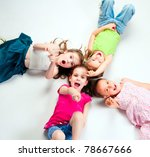 laughing small kids on a light background - stock photo