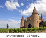 The castle of Corcelles in France with its vineyard - stock photo