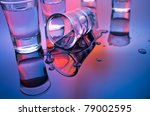 drink shot glasses with reflection in mixed light - stock photo