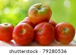 Red tomatoes on table. - stock photo