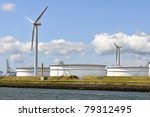 oil terminal and wind turbines - stock photo