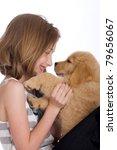 a cute young girl holding a Golden Retriever Puppy - stock photo