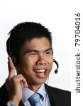 Portrait of a businessman using headphones and smiling against white background - stock photo