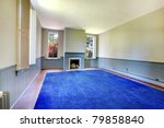 Large empty living room with blue rug and fireplace. Amazing home from 1856 has never been touched since then. All details remain original. Lakewood, Washington State, US. - stock photo