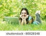 Happy student using laptop outdoors. - stock photo