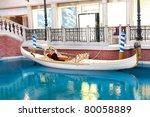 White venetian gondola on blue water - stock photo