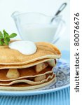 Sweet crepes with apple caramel and cream - stock photo
