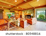 Cowboy ranch in Washington State with leather sofas and stone fireplace. - stock photo