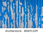 old blue paint peeling from metal surface - stock photo
