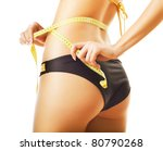 slimming woman in panties with measure on white background - stock photo