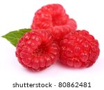 Ripe raspberry with leaves - stock photo