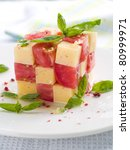 Tomato and cheese appetizer with olive oil and basil. Selective focus - stock photo