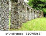stone wall garden of a monastery - stock photo