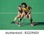 BLOEMFONTEIN, SOUTH AFRICA - FEBRUARY 7: Gaelle Valcke (L) and Marsha Marescia (R) during a women's field hockey match between South Africa and Belgium, Bloemfontein, South Africa, 7 February 2011 - stock photo
