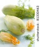 Zucchini with zucchini flower on background. Selective focus - stock photo