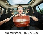Robbery, businessman grasped in hostages. - stock photo
