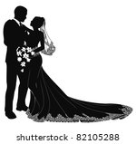 A bride and groom on their wedding day about to kiss in silhouette - stock photo