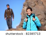 Hiking people. Hiker woman portrait outdoors in mountain scenery. Man in background. - stock photo
