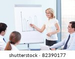 An attractive woman tells a presentation at the office - stock photo