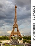 Eiffel Tower - Paris travel icon. Day with dramatic sky. - stock photo