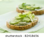 Wholegrain healthy sandwich with cucumber and cabbage. Selective focus - stock photo