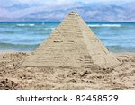 sandy pyramid by the beach - stock photo