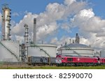 oil  refinery with red oil transport train - stock photo