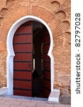Marrakesh, Morocco:  Detail of an ornate wooden door outside a riad in Marrakesh, Morocco. - stock photo