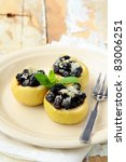 dessert of baked apple with raisins and sugar - stock photo