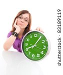 woman holding big green clock - stock photo