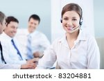 Young girl with a call center in the office - stock photo