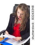 Business woman reading paper - stock photo
