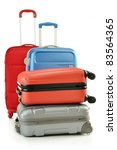 Luggage consisting of four polycarbonate suitcases isolated on white - stock photo