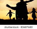 Group of happy children running on meadow, sunset, summertime - stock photo