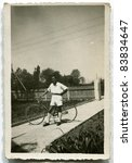 Vintage photo of young man with bike (forties) - stock photo