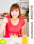 Beautiful woman having a healthy breakfast - stock photo