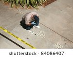 CSI Crime Scene with Chalk Outlines and Sheriff do not cross caution tape. shot outside in direct daylight with shadows. - stock photo