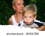 Blowing the candle while mother is not watching (2:yr old) - stock photo