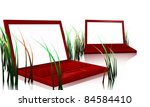 red designer laptops that looks like pc with green grass and white screens - stock photo