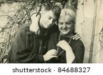 Vintage photo of mother with son (sixties) - stock photo