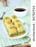 traditional Turkish dessert - baklava with honey and nuts - stock photo