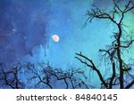 background picture with skeletal trees with snow on their branches against the night sky with moon and watercolor paper for texture - stock photo