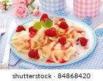 homemade ravioli ( pierogi ) with cottage cheese,sour cream,fresh raspberry and cinnamon - stock photo